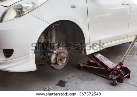 Car Wheel is Being Maintained on Professional Car Repair Station - stock photo