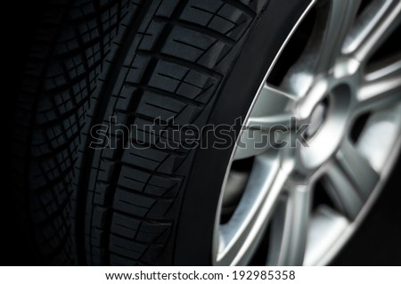 Car wheel on a car,  close-up, low key