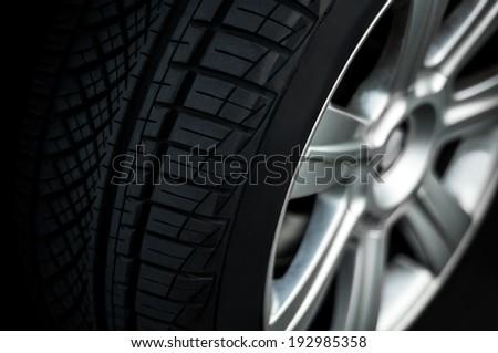 Car wheel on a car,  close-up, low key - stock photo