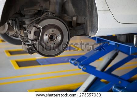 car wheel tire replacement, car wheel hub, disc brake, fix, repair, change - stock photo