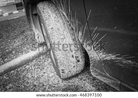 Car wheel with mud - selective focused - black and white
