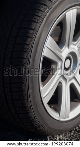 Car wheel with used tire on a car �¢?? close-up - stock photo