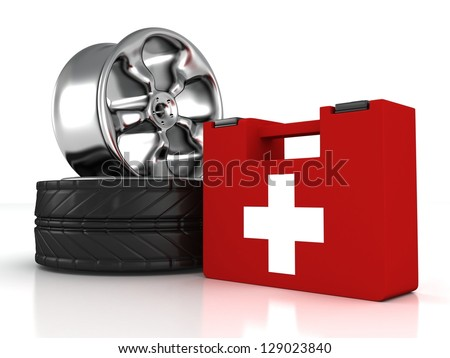 car wheels and first aid help kit - stock photo