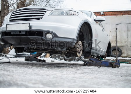 Car wheels on service changes in winter outdoor