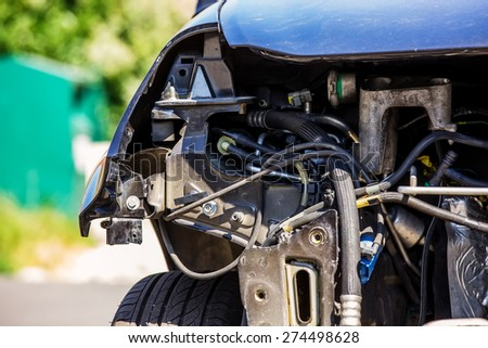 car whose engine has been completely removed - stock photo