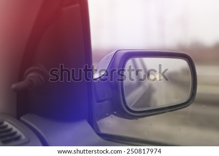 Car Wind Mirror, Selective Focus with Shallow Depth of Field. - stock photo