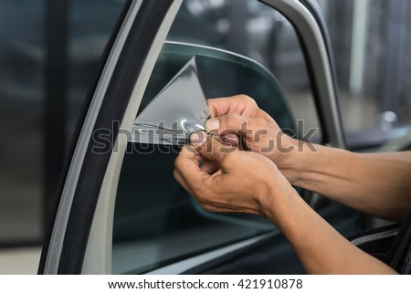 Car window tinting series : Removing old film - stock photo