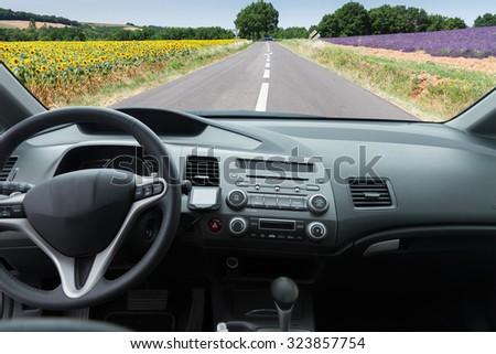 car windscreen with  country road, view  inside out - stock photo