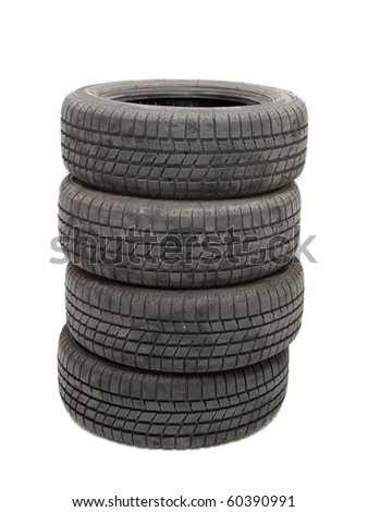 Car winter tyres in a pile - stock photo