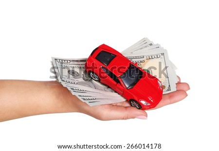 car with cash in female hand isolated on white background