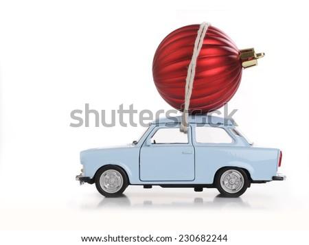 car with Christmas ball - stock photo