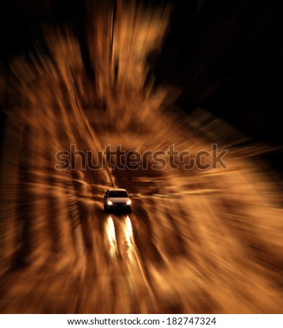 Car with headlights shinning on stormy wet road driving in the rain - stock photo