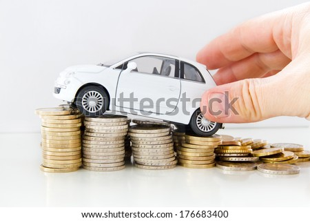 Car with helping hand on coins - stock photo