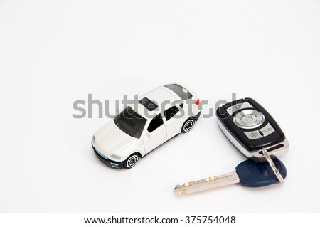 Car with keys on a white background isolated - stock photo