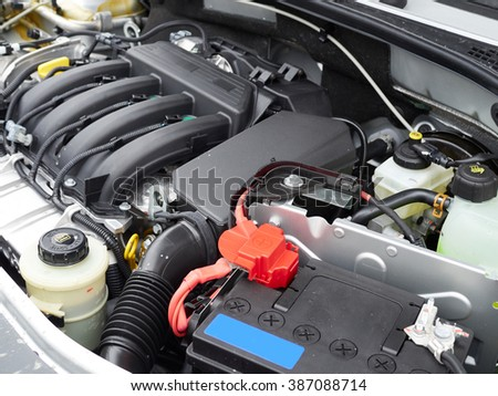 Car with open hood.Battery. Details of new car engine. - stock photo