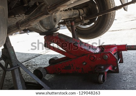 Car with tire at jack in service