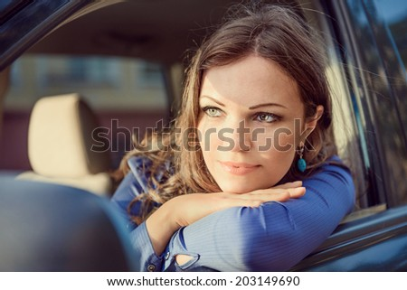 Car woman on road trip looking out of window. Having rest on sunset. - stock photo