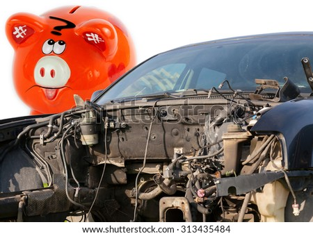 Car wreck and orange piggy bank style money box   - stock photo