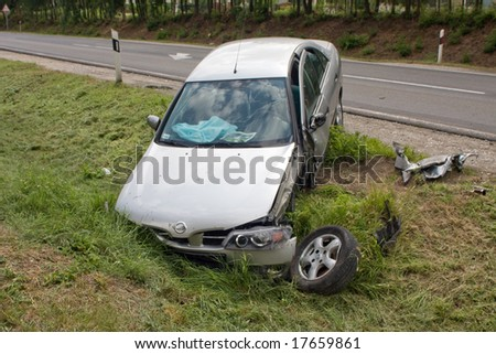 car wreck near to road - stock photo