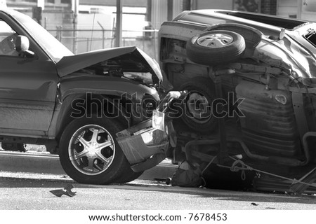 Car Wreck with Smashed Hood and Car On Side