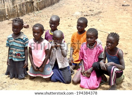 CARABANE,SENEGAL-APRIL 15, 2014: Group of children pose for the tourist in the street on April 15, in Carabane-Senegal.