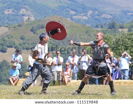 CARABANZO, SPAIN - AUGUST 19: Two unidentified men participate in a recreation of the battle between the Romans and Asturian on August 19, 2012 in Carabanzo, Spain. - stock photo