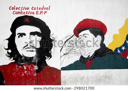 CARACAS, VENEZUELA, APRIL 20: Graffiti of Hugo Chavez President with Che Guevara designed by unknown artist on a white wall in Caracas city. Venezuela 2015. - stock photo