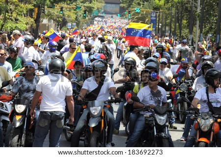 CARACAS, VENEZUELA - MARCH 22, 2014: Venezuelans protest in the street against the government for human rights violations and killings of civilians in peaceful demonstrations