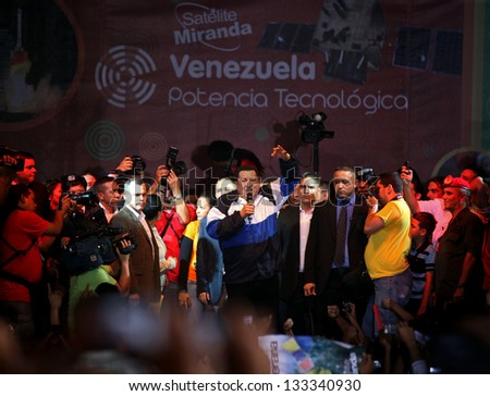 CARACAS, VENEZUELA-SEP 28: Hugo Chavez, President of Venezuela, greets a crowd ahead of launching of Venezuela's second satellite (named Miranda) celebrations, on Sep. 28, 2012 in Caracas, Venezuela - stock photo