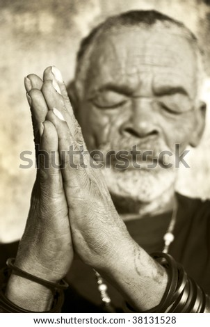 Caracterful senior African man with folded hands