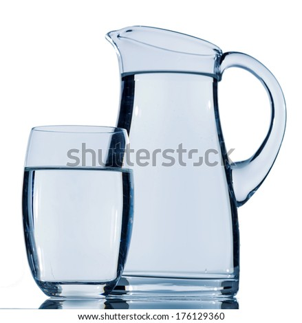 carafe and a glass of water, symbolic photo for drinking water, refreshment, demand and consumption - stock photo