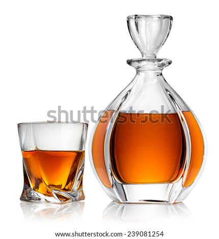 Carafe and glass of whiskey isolated on a white background - stock photo