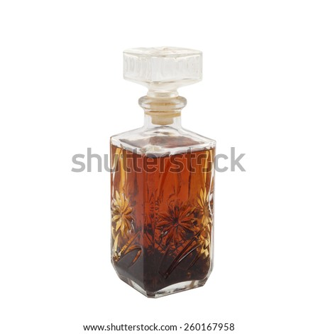 Carafe with cognac with herbs - stock photo