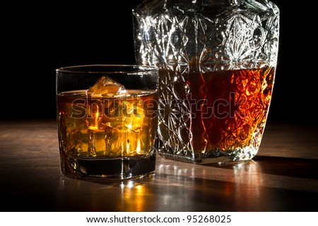 Carafer and glass with ice with whisky - stock photo