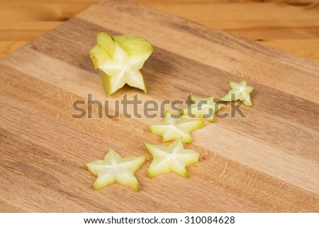 Carambolas - Starfruits on a wooden surface