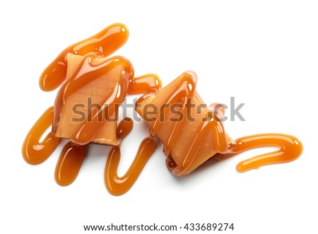 caramel candies and sweet sauce isolated on white background, top view - stock photo