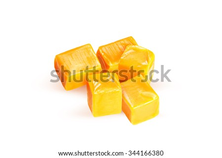 Caramel candies isolated on a white background - stock photo