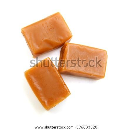 caramel candies isolated on white background - stock photo
