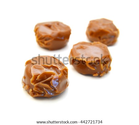 caramel candies isolated on white background