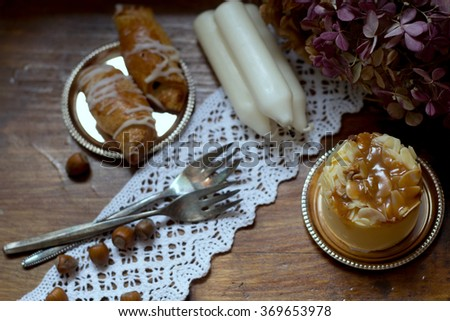 caramel cheesecake, candles, croissants and nuts