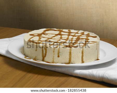 caramel chocolate cake, on a wood background