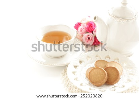 Caramel cookie and English tea - stock photo
