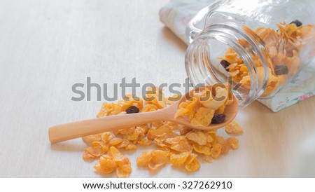 Caramel cornflake in spoon on wooden table,Selective focus on cashew nut. - stock photo