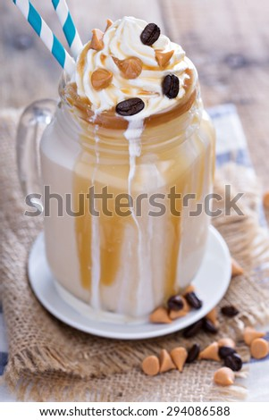 Caramel frappuccino with syrup in mason jar - stock photo