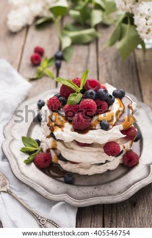 Caramel Pavlova Cake with fresh berries