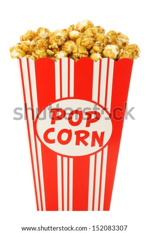 caramel popcorn in a decorative paper popcorn cup isolated on a white background