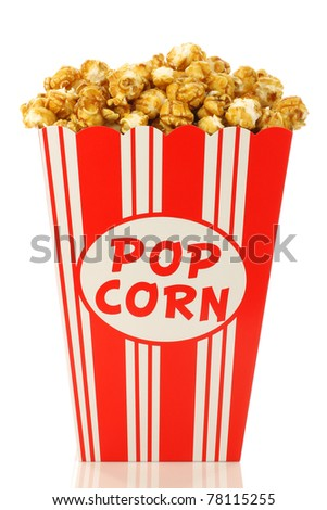caramel popcorn in a decorative paper popcorn cup on a white background - stock photo