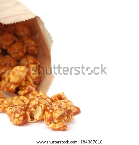 caramel popcorn in paper box isolated on white background - stock photo