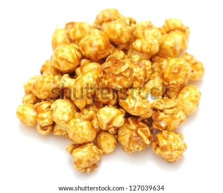 caramel popcorn on white background - stock photo
