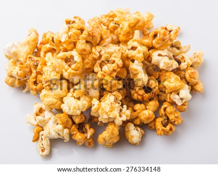 Caramel popcorn over white background